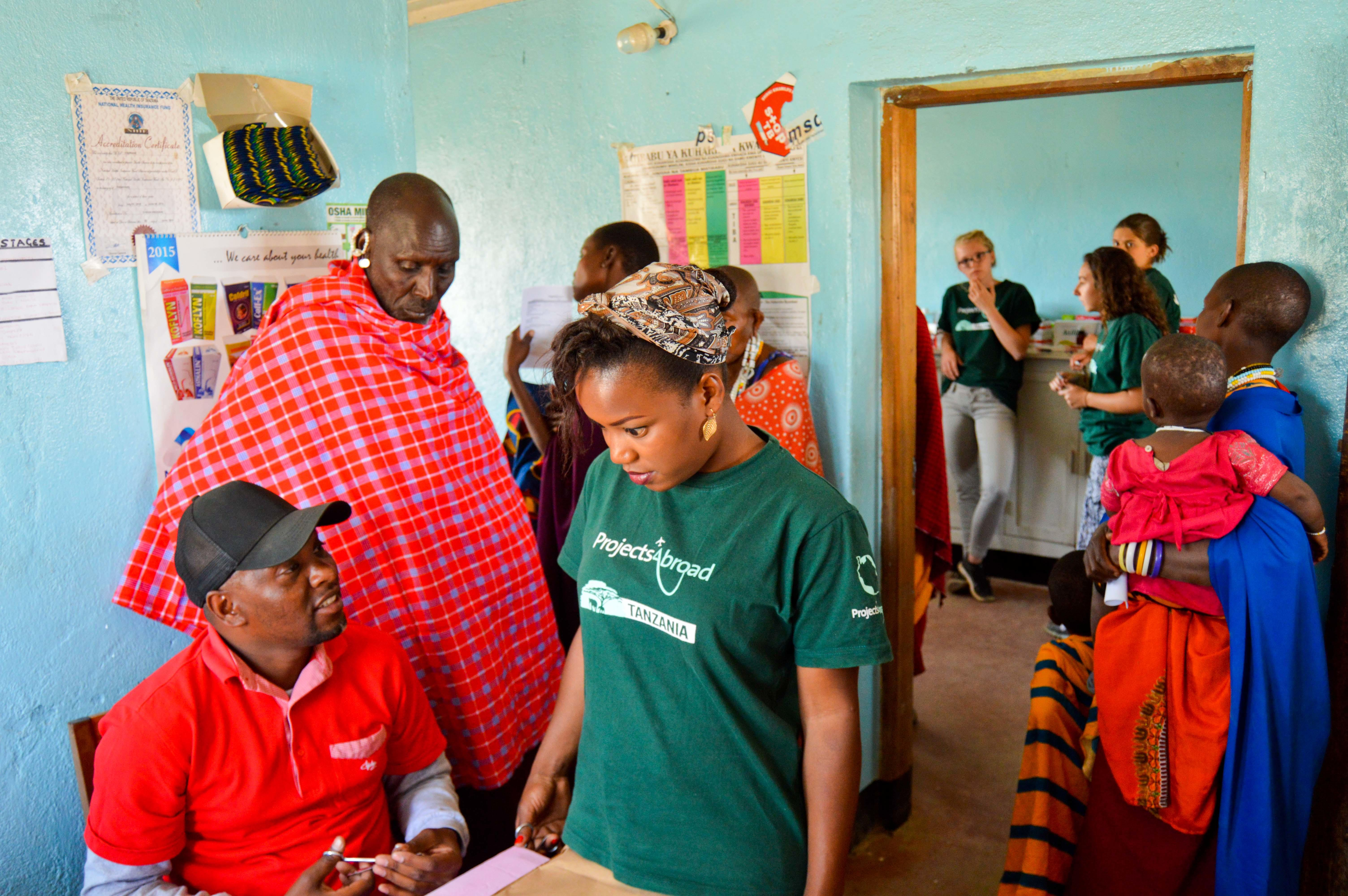 Two Projects Abroad interns on a nursing internship in Tanzania have a quick chat at a medical outreach.